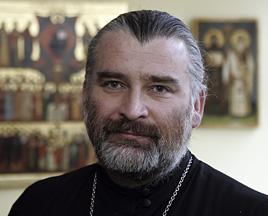 Porträtfoto von Vater Andrej Sikojew
